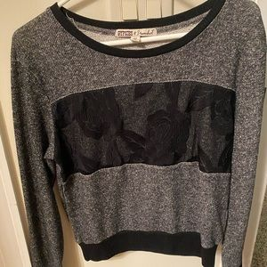 Sweaters - Black and grey sweater with a flower on it